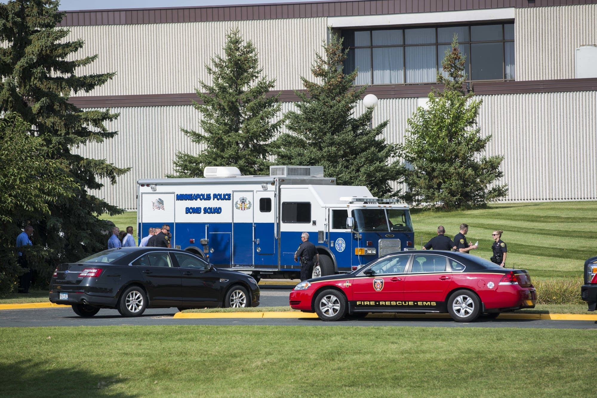 A bomb squad truck sits outside Hennepin Technical College