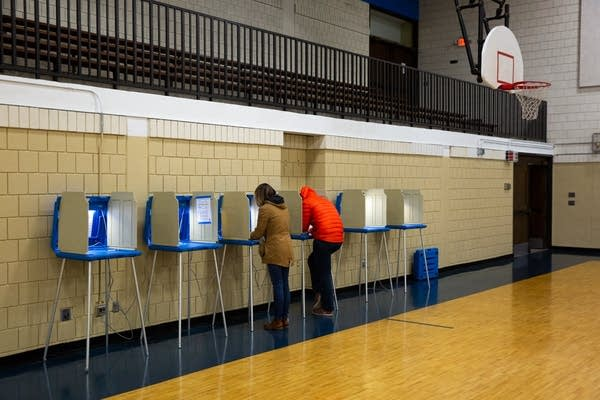 6 voting booths, 2 voters, 1 basketball hoop.