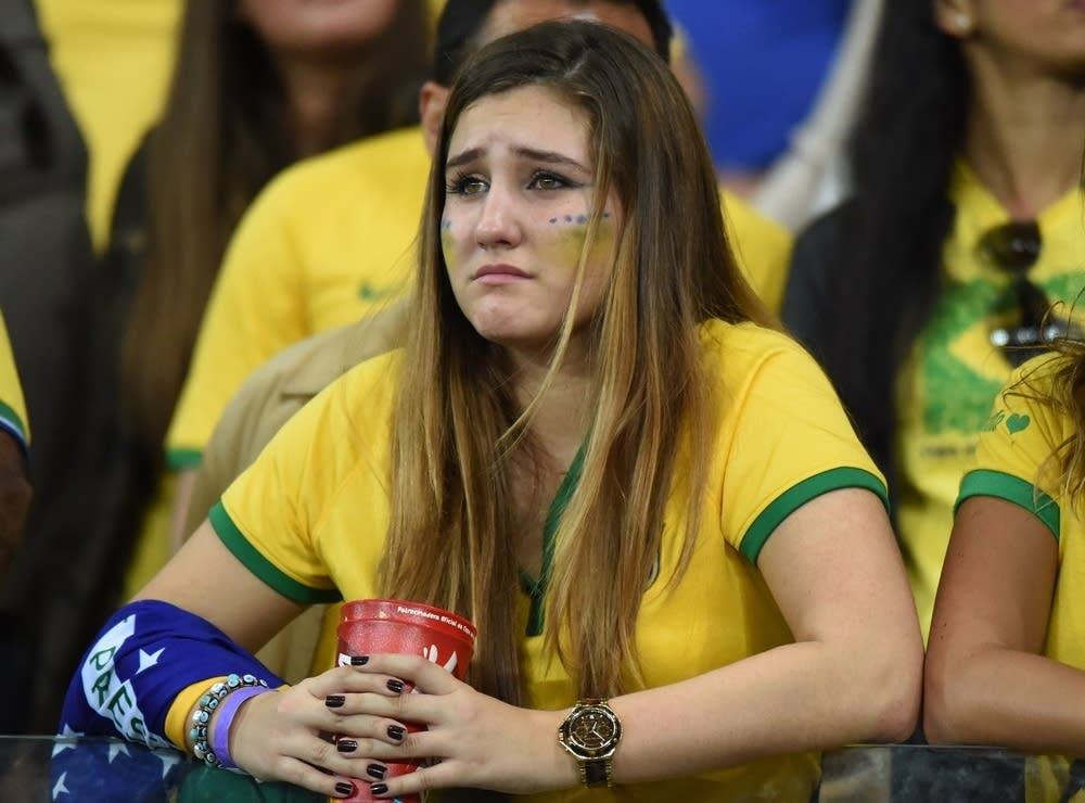 A Brazilian fan reacts