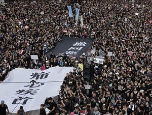 Protesters carry a huge banner in Hong Kong