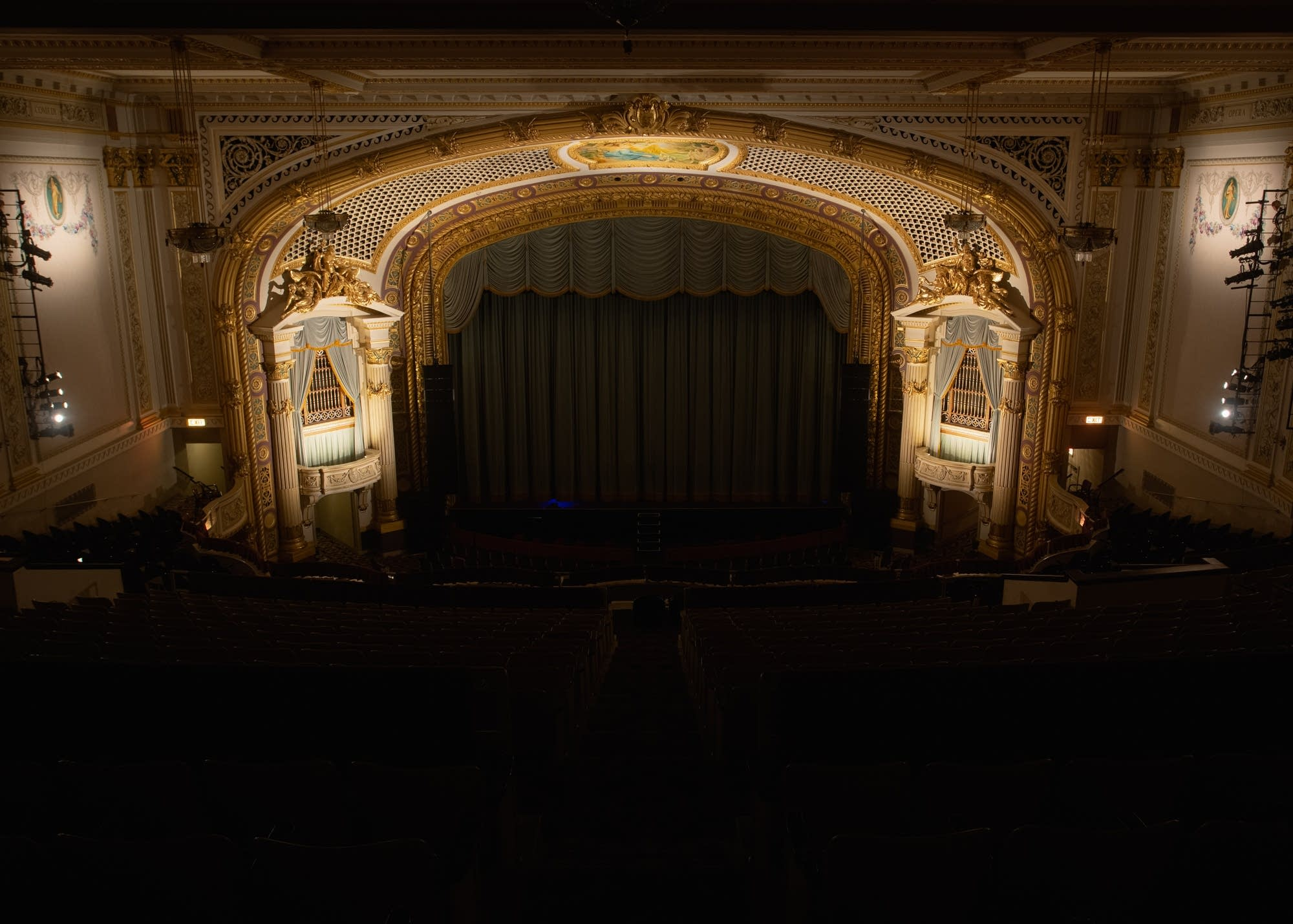 The State Theatre auditorium is lit, but the curtain-shrouded stage is dark