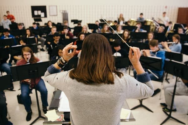 Nora Tycast conducts her band class.