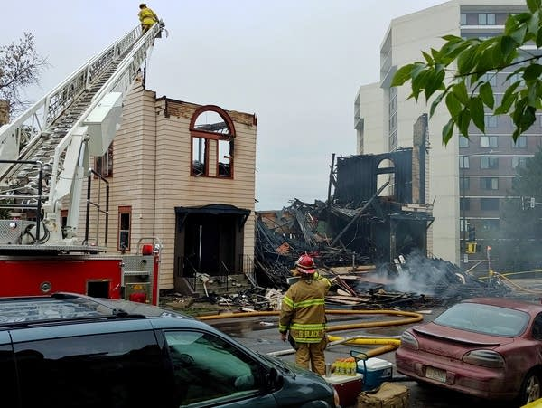 Firefighters work the scene of an overnight fire
