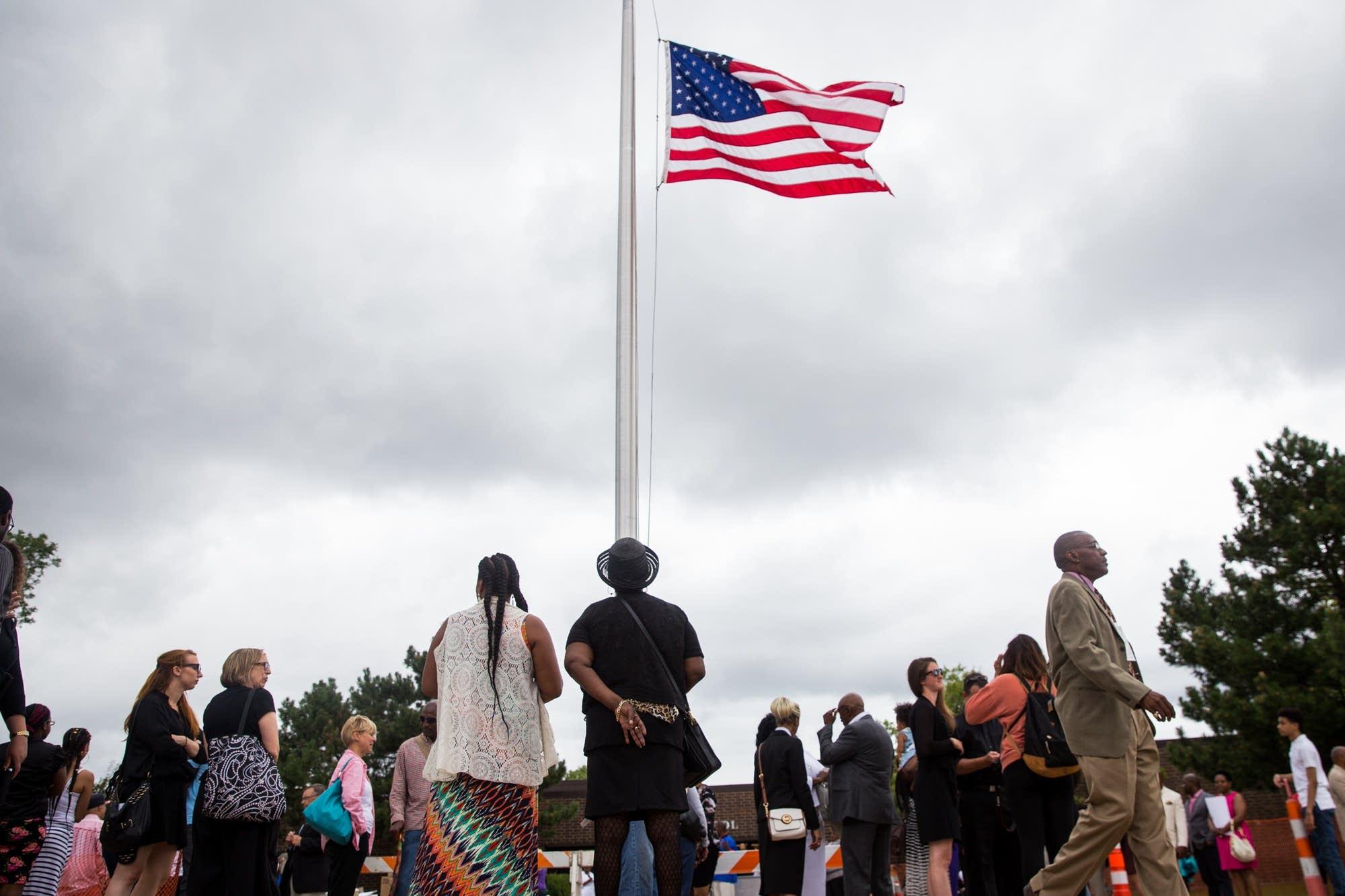 The flag outside J.J. Hill flies at half staff.