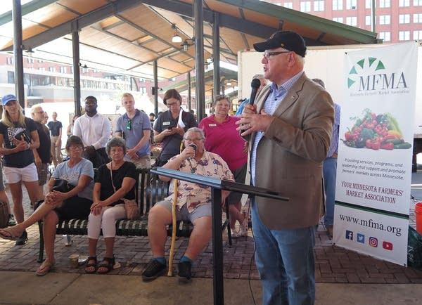 Minnesota Gov. Tim Walz speaks at an event at the farmer's market