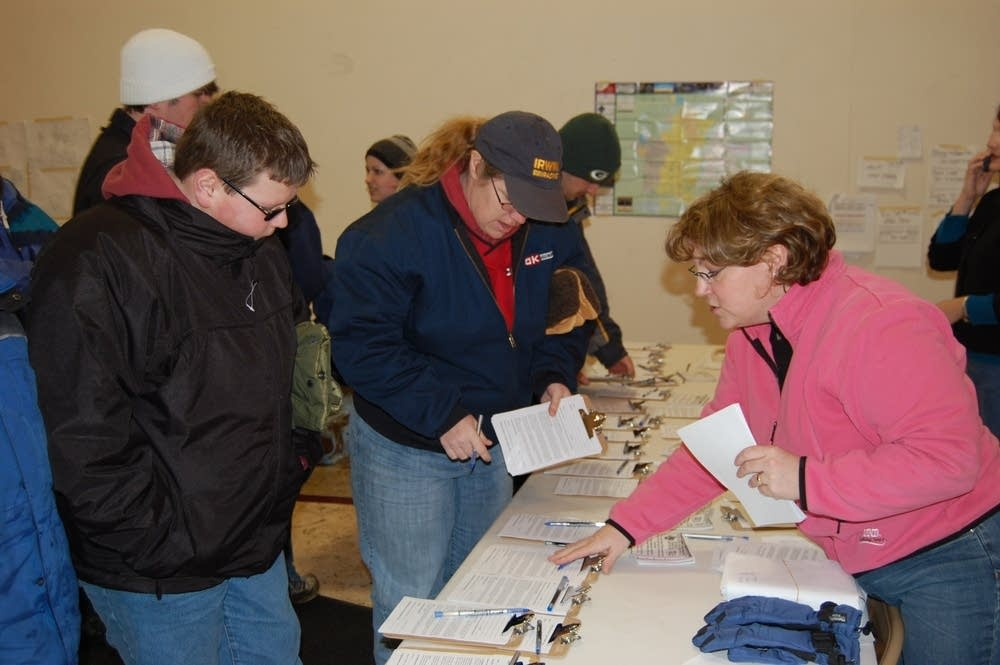 Volunteers signing up