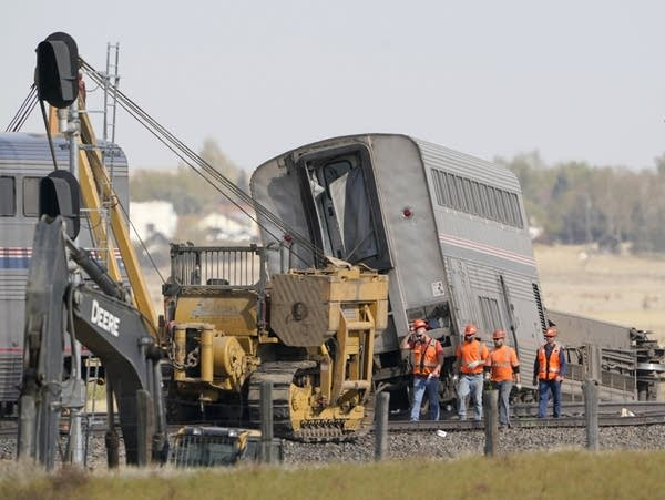 Workers at the scene of a train derailment