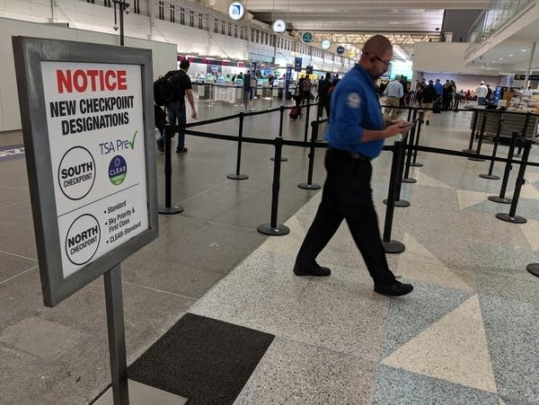 A TSA officer walked through the ticketing level at the airport.
