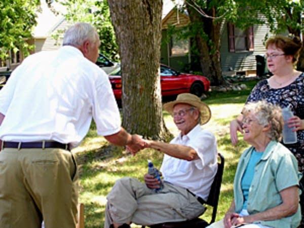 Kline shakes hands