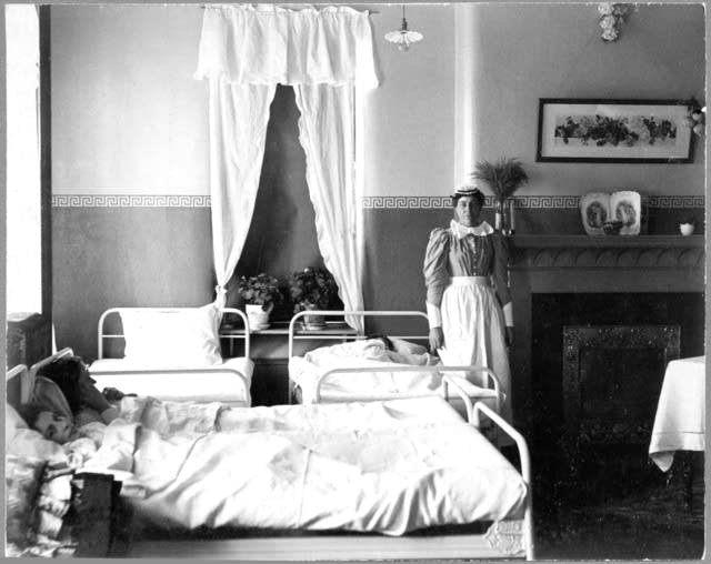 Nurse with patient in Fergus Falls State Hospital, approximately 1900.