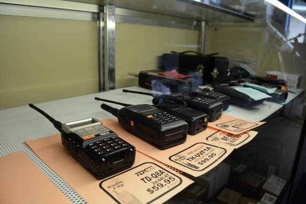 A collection of used 2 meter and 70 centimeter handheld radios for sale