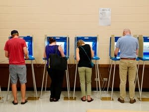 People vote at the Pershing Park Recreation Center.