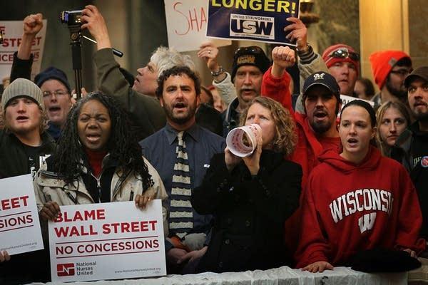 Protestors yell