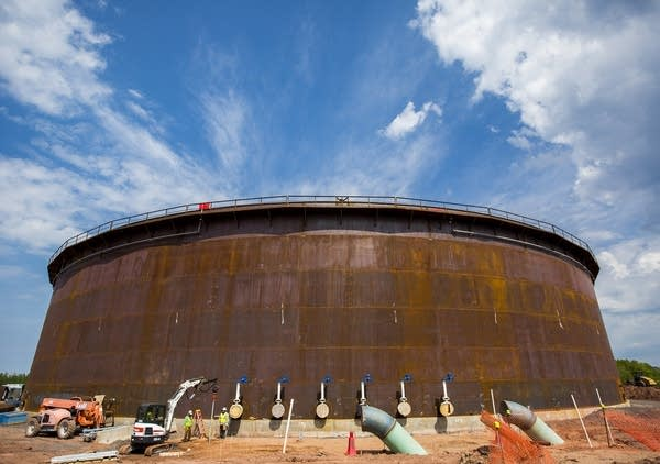 A large storage tank for oil nears completion.