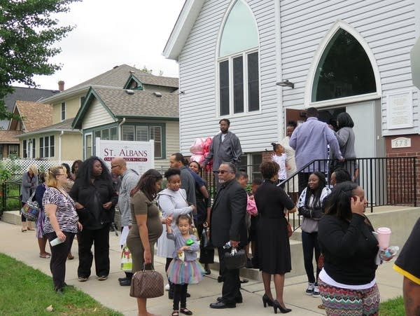 Parishioners gather outside St. Albans Church of God in Christ