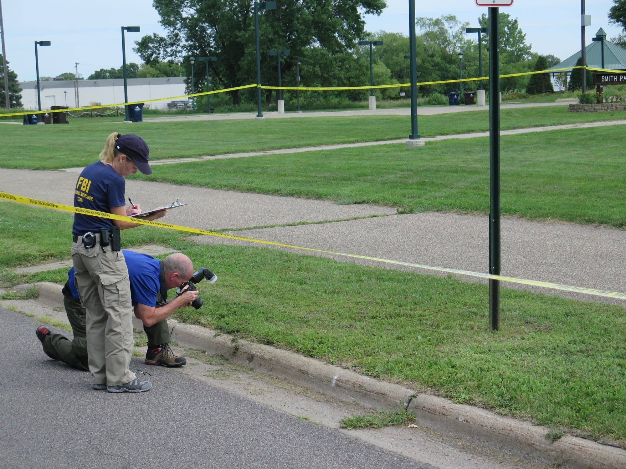 ATF and FBI agents search the grounds of the Dar Al-Farooq Islamic Center