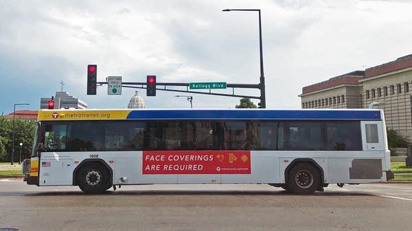 An ad on a Metro Transit bus says masks are required to get on buses.