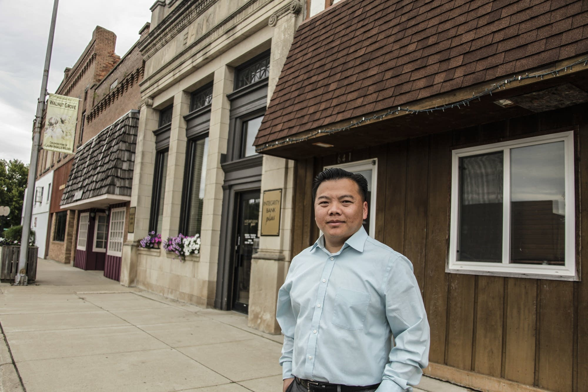 Xiong Yang stands on the main street in Walnut Grove.
