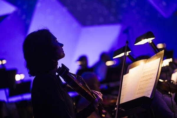 A Minnesota Orchestra Musician rehearses.