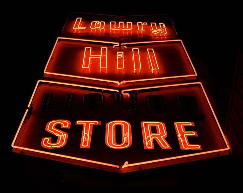 The Lowry Hill Liquor Store sign