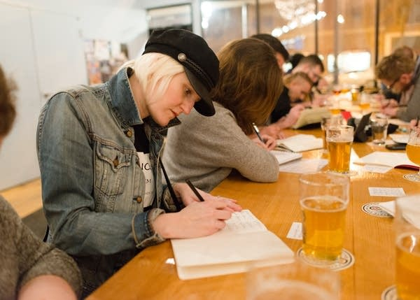 Kristin Brown practices cursive handwriting at Fair State Brewing Coop.