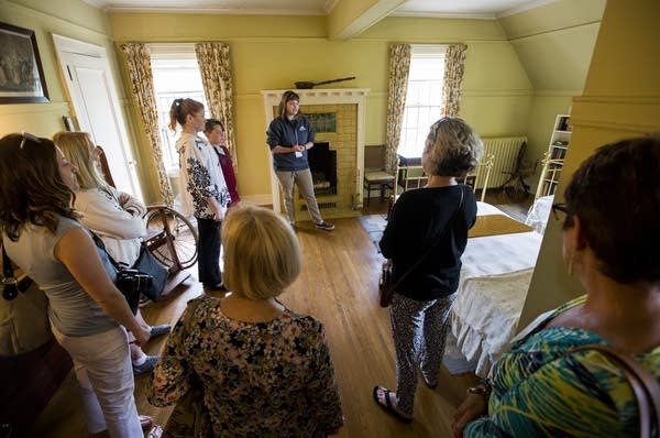 A tour guide shares facts and details about the mansion and Congdon family.
