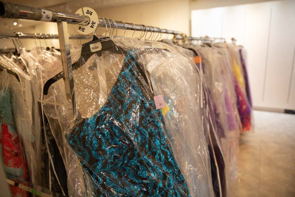 Some of the 3,000 prom dresses are hung in Southdale Center.