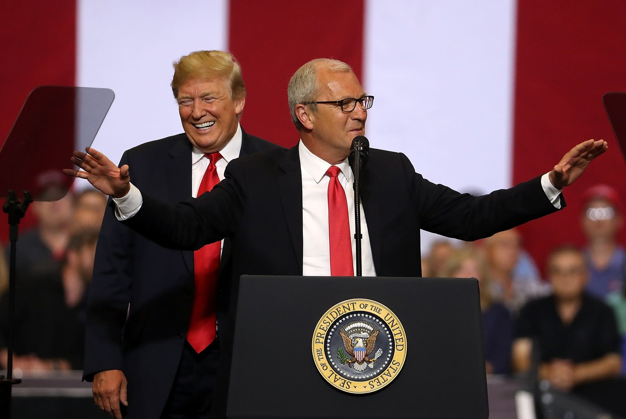 President Trump looks on as U.S. Rep. Kevin Cramer speaks to supporters.