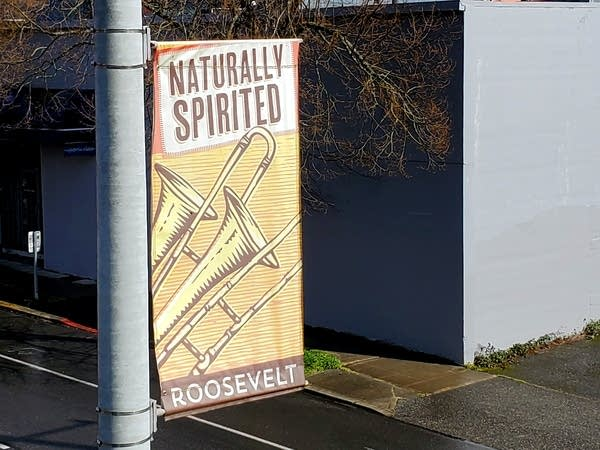 """A banner hangs outside Andrew's home: """"Roosevelt: Naturally Spirited"""""""