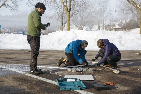 Researchers assemble equipment in the parking lot of Surfside Park