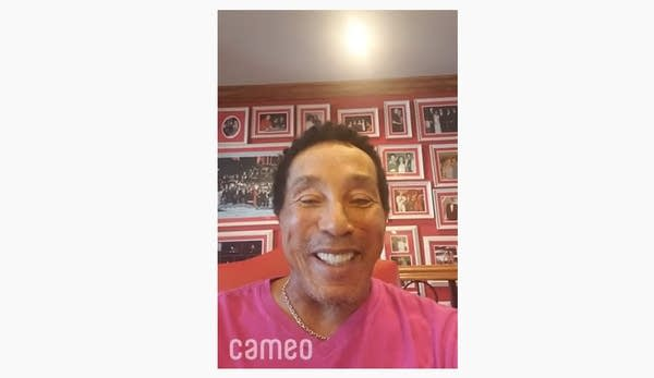 80-year-old Smokey Robinson recording a video message in a den