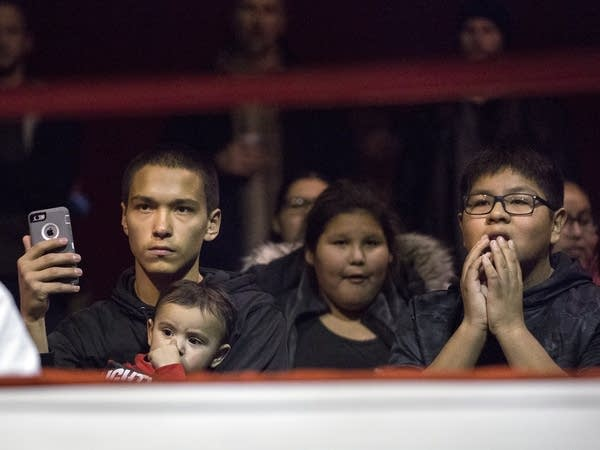 Antonio Varney, left, watches the fights from ringside.