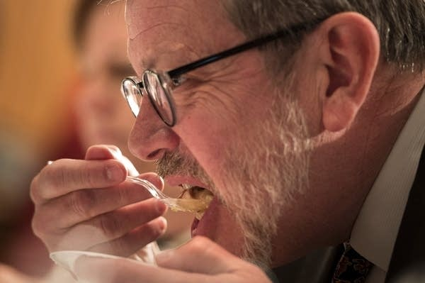 Eric Kaler tastes an entry during the hotdish competition