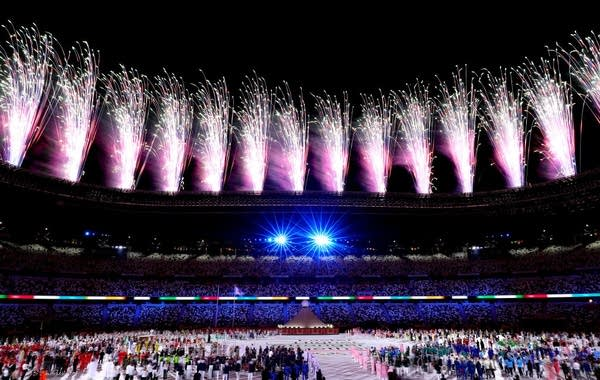 Fireworks are set off the the Tokyo Olympics opening ceremony.