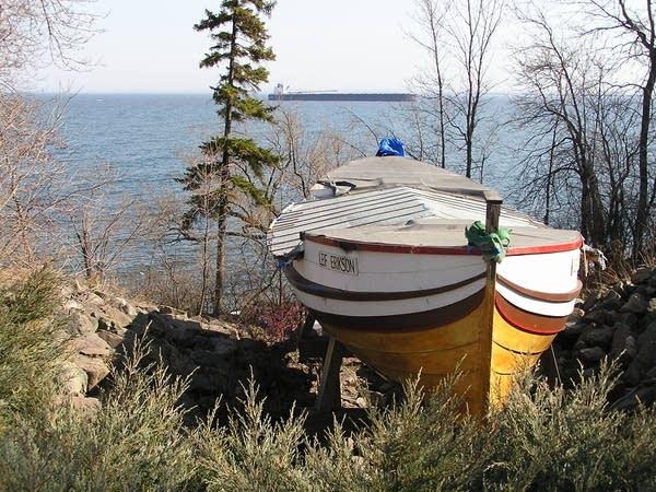 Lake freighter sails past Leif Erikson ship
