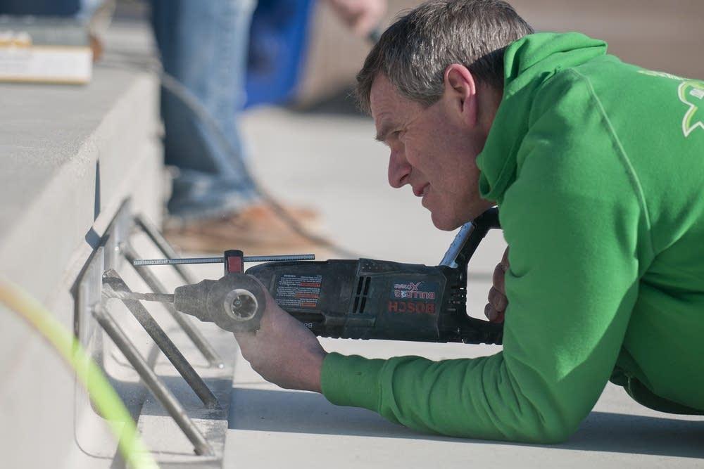 Dale Stevermer drills holes