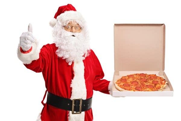 Santa holding a pizza