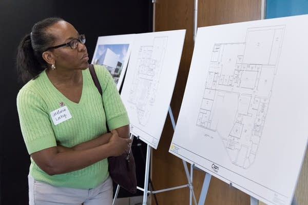 Melanie Leehy looks over blueprints for the new Capri Theater.