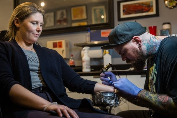 Lindsay Wenner gets her second tattoo.