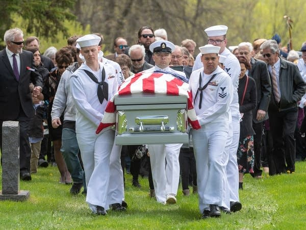 A U.S. Navy honor guard carries the remains of Dante Tini