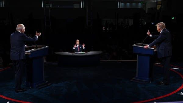 Two men debate.