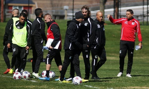 Head coach Manny Lagos, right, instructed players.