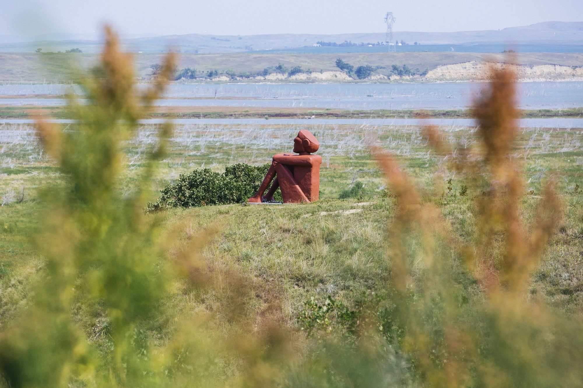 A statue sits overlooking the site of the 3 protest camps.