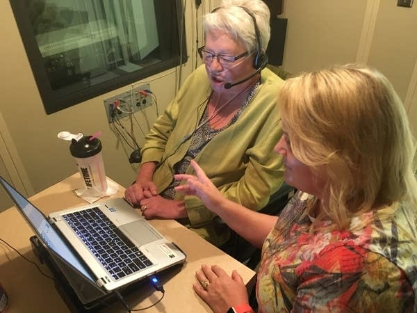 Judy Bernhardt records personalized messages in an audio booth.