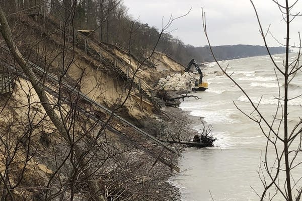 Work continues to rebuild the eroded beach in Fennville, Mich.