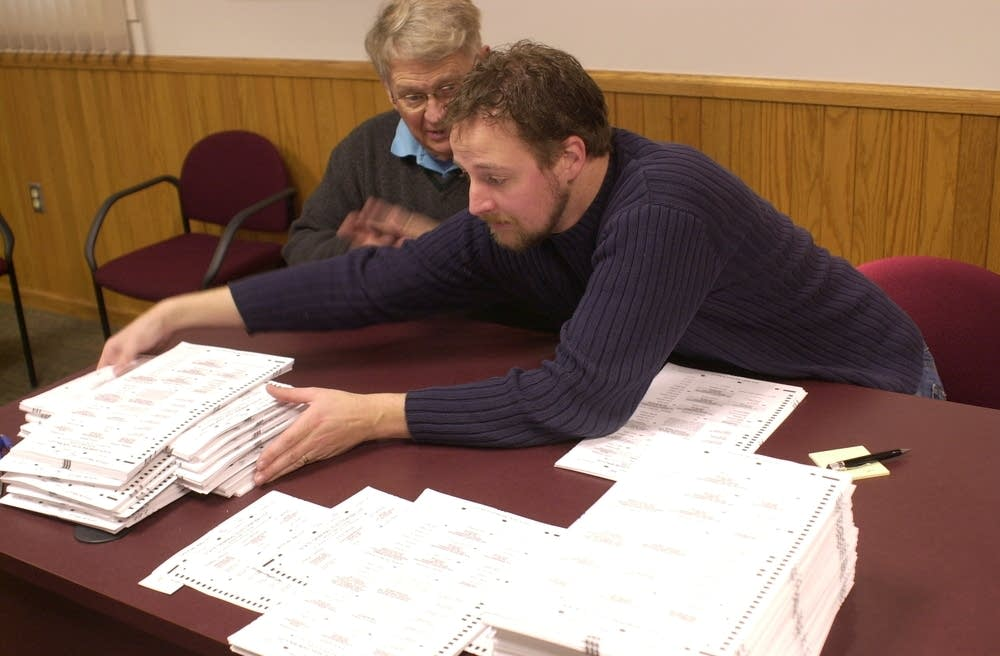 Ballots being re-counted by hand