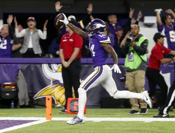 Wide receiver Stefon Diggs (14) runs in for a game winning touchdown.