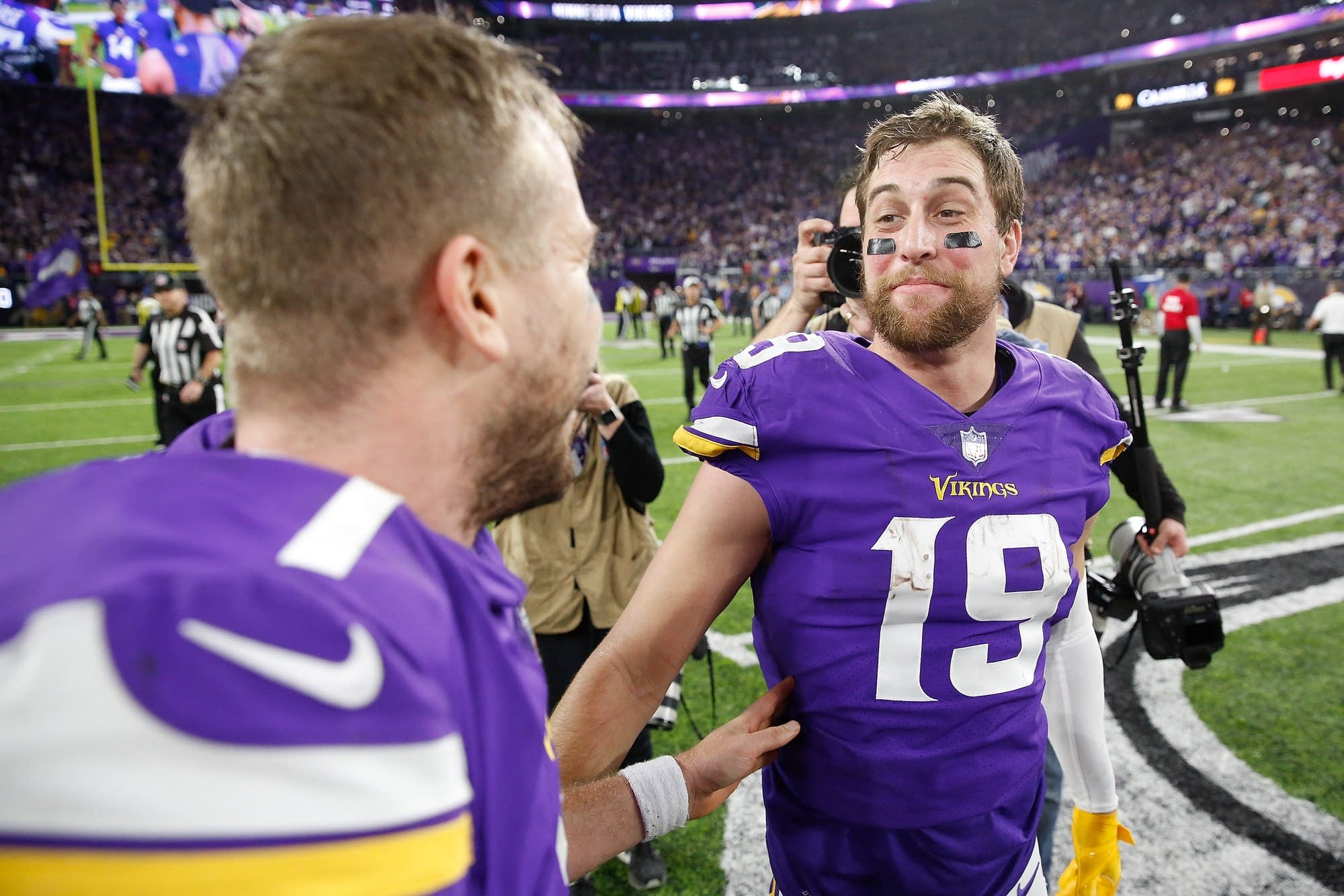 Case Keenum celebrates with Adam Thielen (#19) after defeating the Saints.