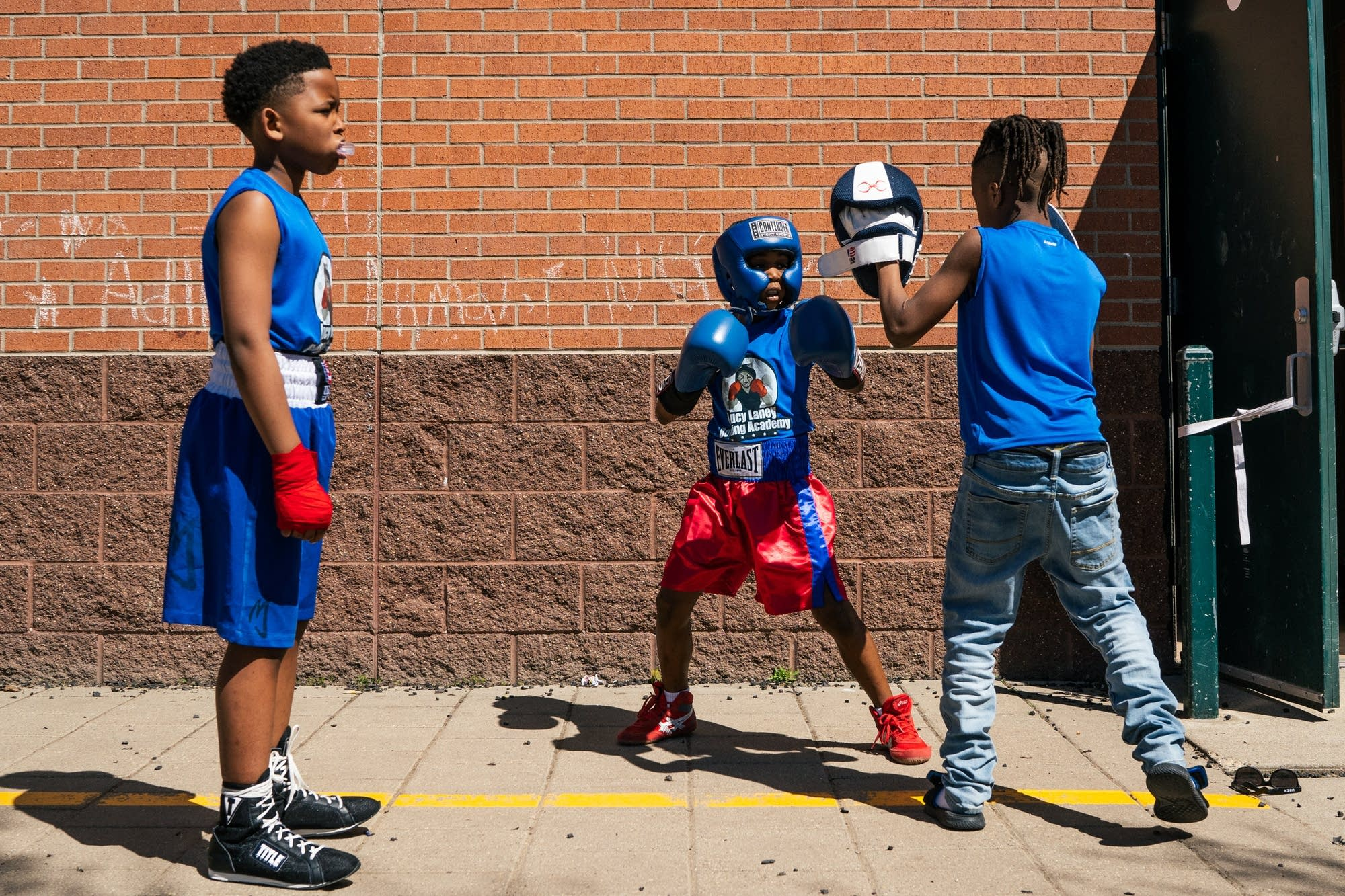 Lucy Laney Boxing Academy fighters warm up outside.
