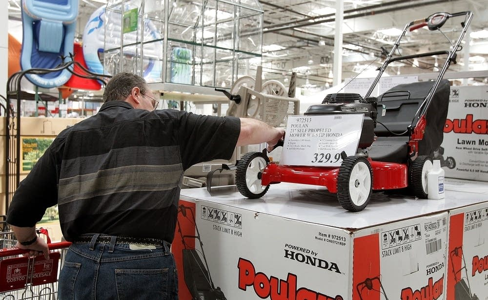 a man looks at a lawn mower at the costco store may 4 2006 in mount prospect illinois tim boyle getty images file